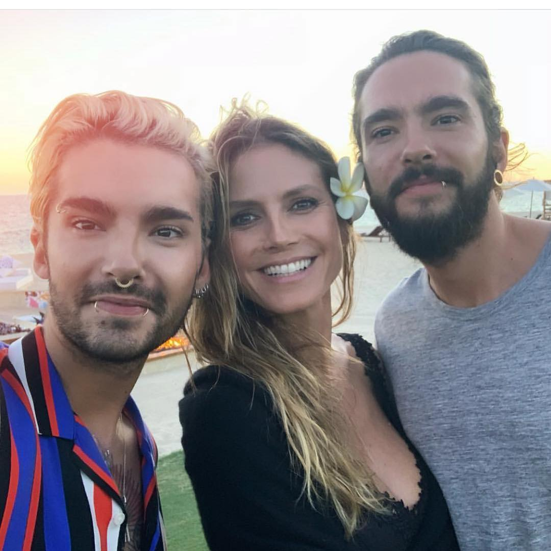 Bill Kaulitz is taking a selfie with his brother, Tom Kaulitz and his fiance, Heidi Klum