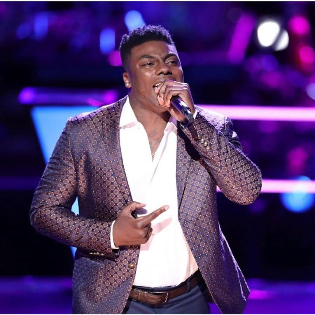 Kirk Jay singing on the stage of The Voice