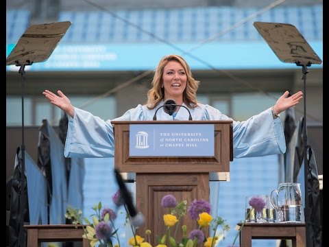 Brooke addresses UNC students in a graduation gown