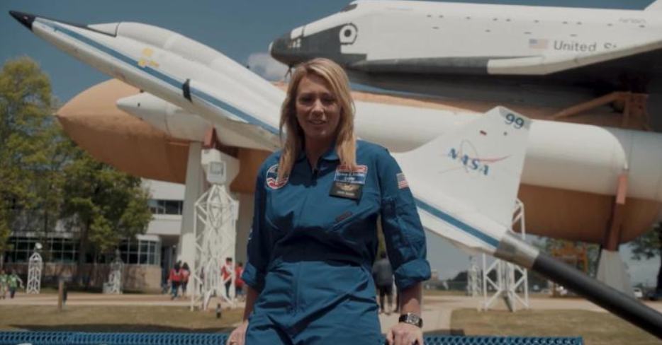 Brooke is seen wearing a blue NASA jumpsuit