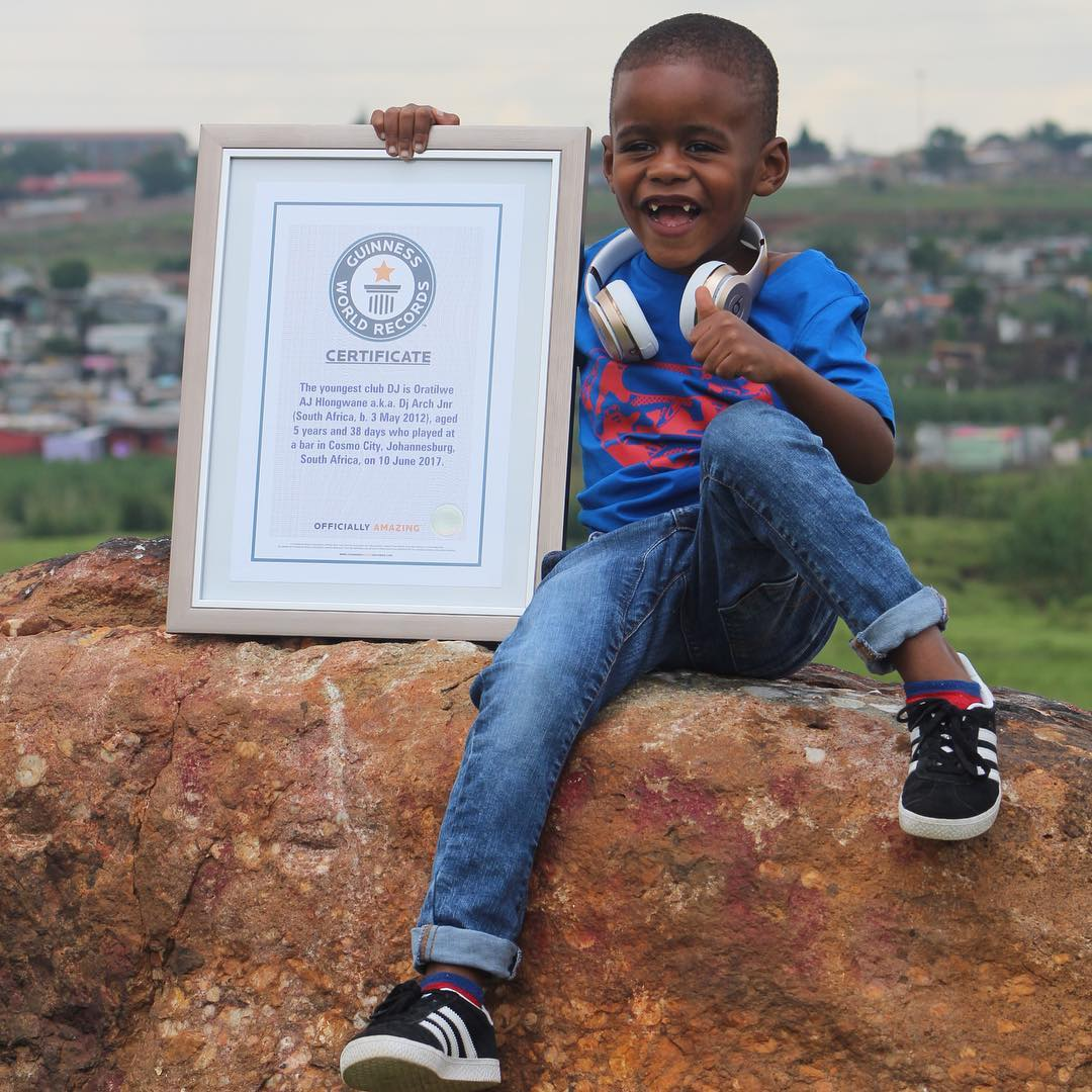 DJ Arch Jnr holding the certificate of Gunniess World Record as the World's Youngest Club DJ
