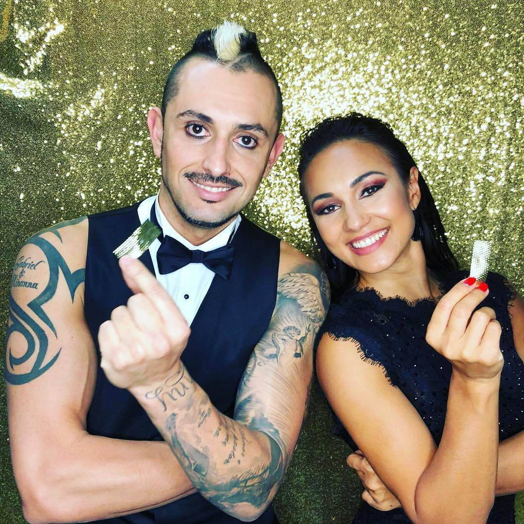 Deadly Games acts (Alfredo and Anna) holding confetti in their hands