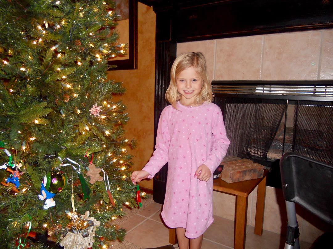 Young Darci Lynne Farmer in front of Christmas tree