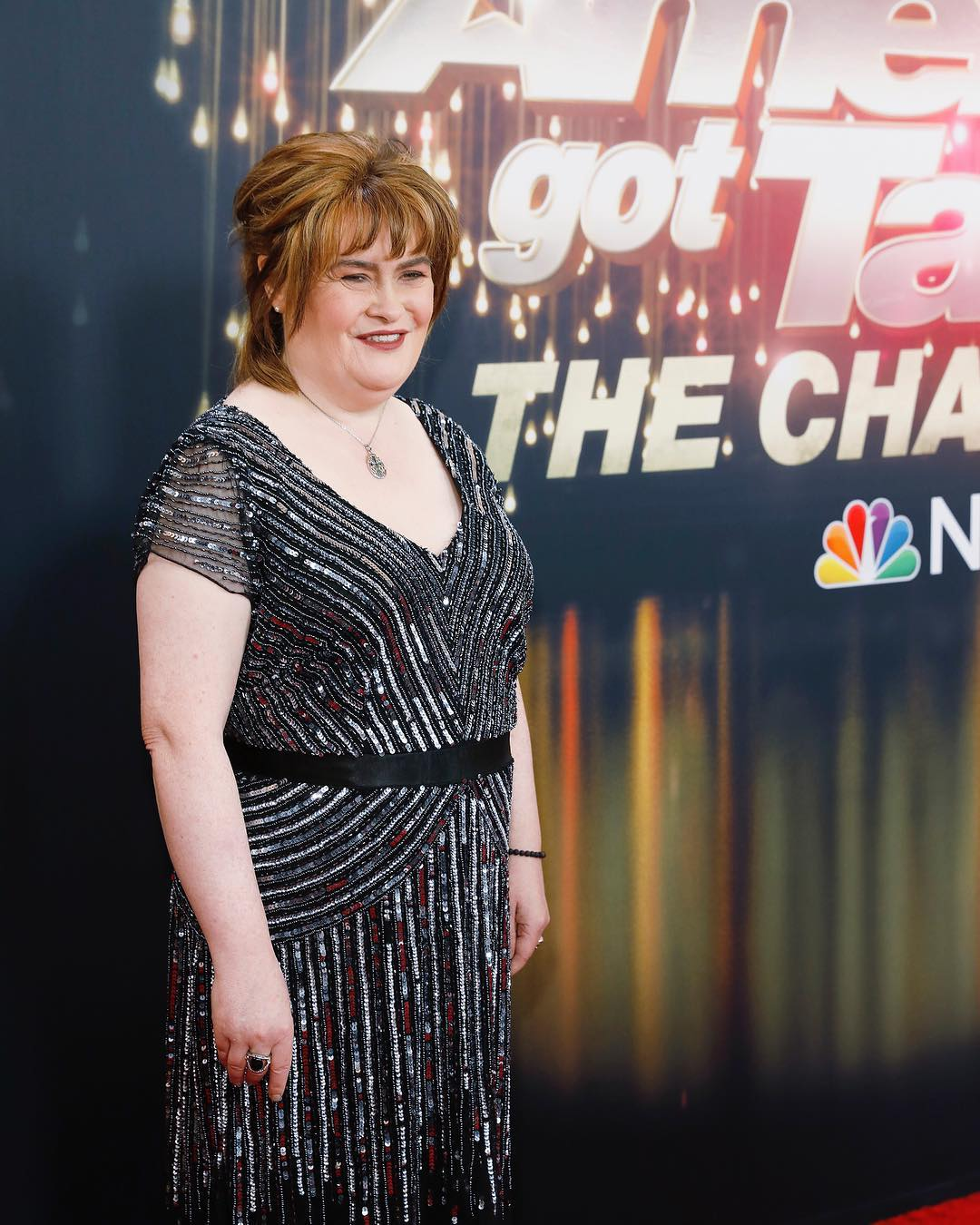 Susan Boyle wearing shiny dress on the set of America's Got Talent: The Champions
