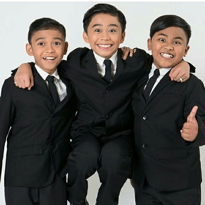 TNT Boys wearing a white shirt and black suit