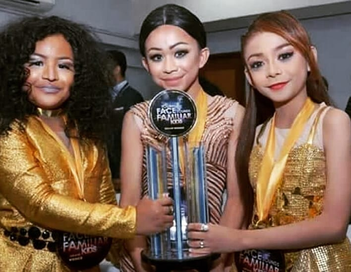 TNT Boys holding their Your Face Sounds Familiar Kids trophy