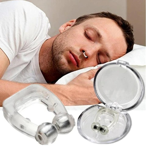 A guy wears an anti-snoring septum.