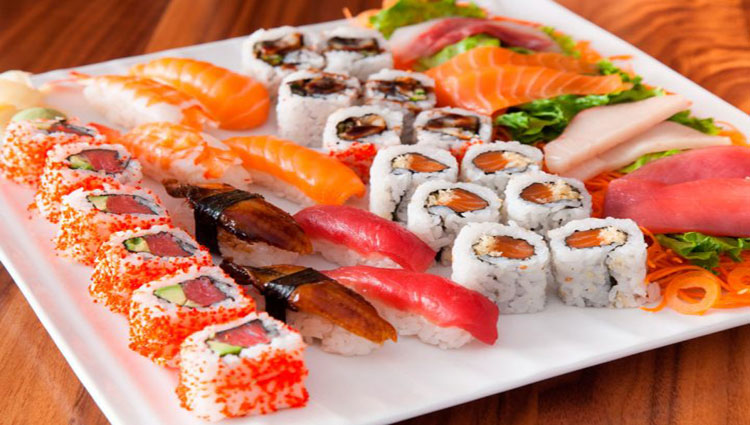 A platter full of sushi and tunas and salmon dishes