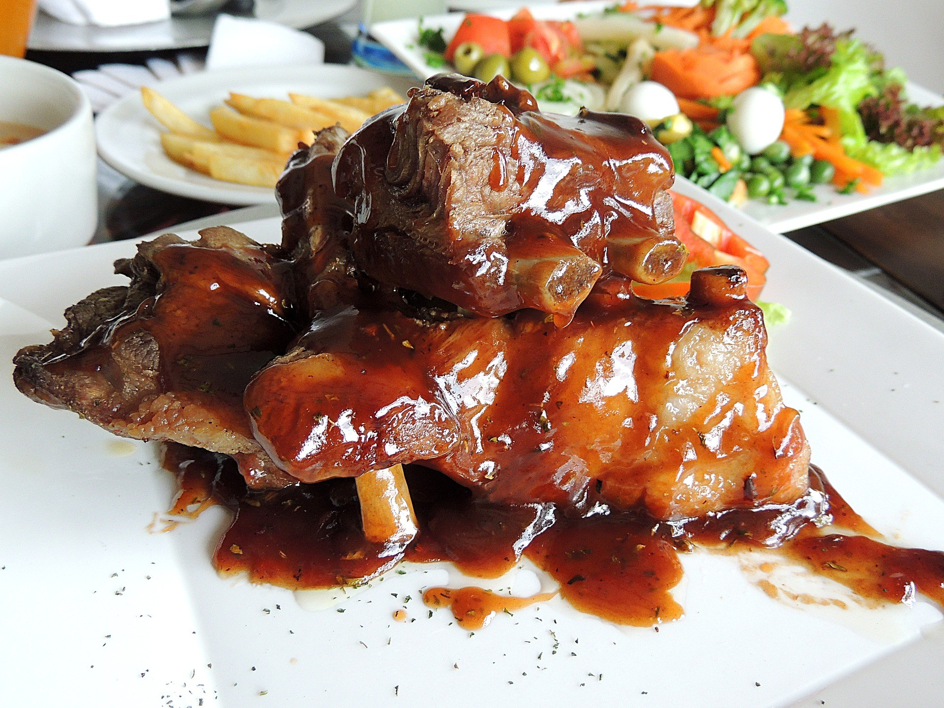 A ribs platter seeming delicious, with all the smoky barbecue effect